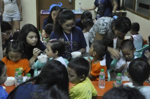 TFCA high school students feeding the children in Bgy. Salapan