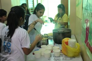 "Grade 7 students preparing ""Sopas"" for the children."